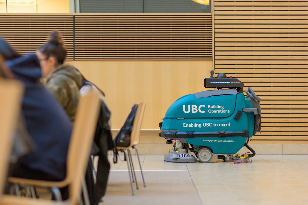 A robotic floor scrubber powered by A&K Robotics follows a preset path in UBC's Life Sciences Centre.